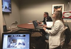 Image of Dr. Arzubi during an ECHO videoconference